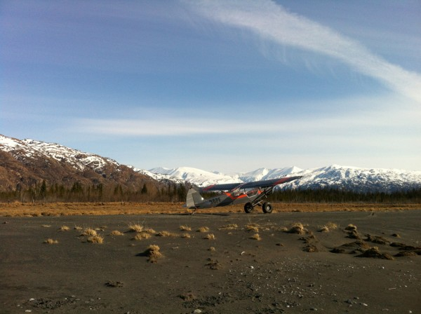 k_Super Cub with Tustumena Glacier and peaks in background