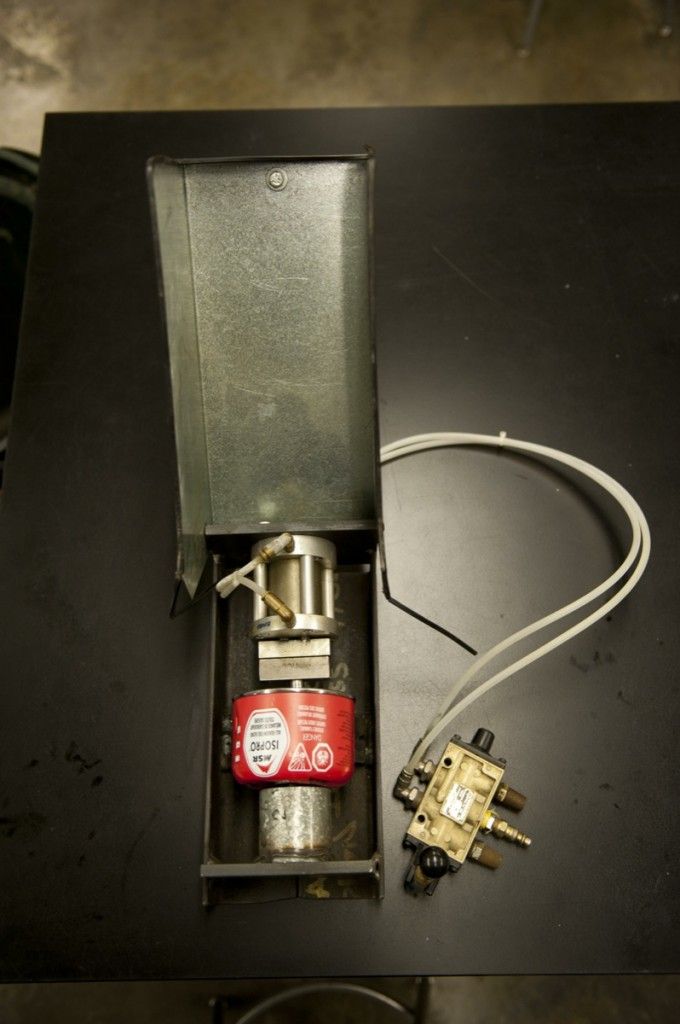 The MSR R&D lab uses this unique machine to puncture and recycle fuel canisters used in stove development projects.