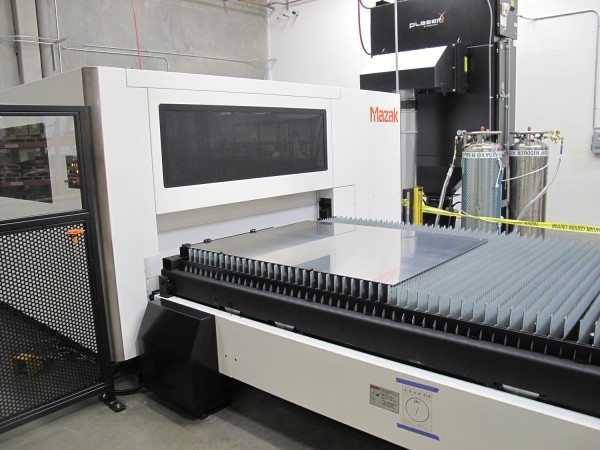 Aluminum sheet getting loaded into the 2D laser-cutting machine.