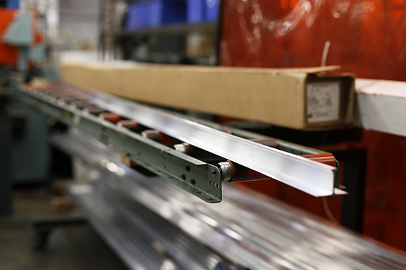 14-foot extruded aluminum T-beam prior to cutting.