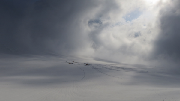 Clouds parting above Mt. Huntington base camp.Photo Jewell Lund