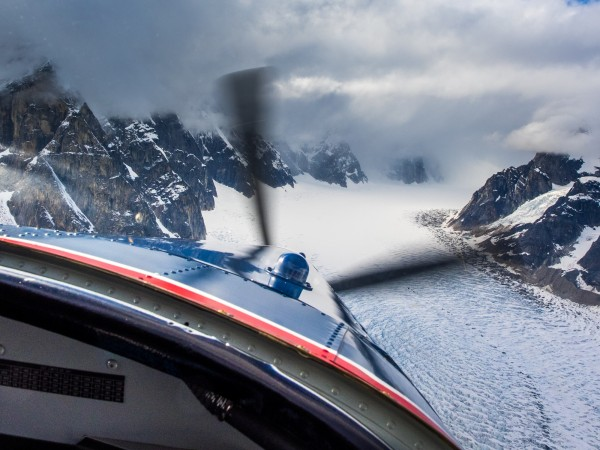 After a three day wait and our share of beers in the town of Talkeetna, which serves as the jumping-off point for flights into the Alaska Range, we were granted a brief weather window and were able to get a Talkeetna Air Taxi flight to the Ruth. Photo: ©Scott Rinckenberger