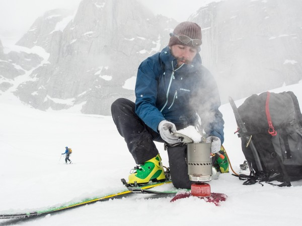 Matt takes a break to melt some snow in the Reactor on a beta mission to the base of the Eye Tooth. Photo: ©Scott Rinckenberger