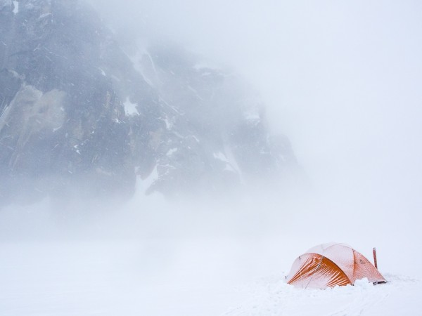 The Stormking tent doing what it does best while we wait at the 'airstrip' in the middle of the glacier. Photo: ©Scott Rinckenberger