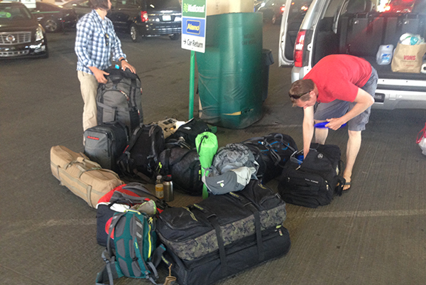 Scott and Kris organizing luggage