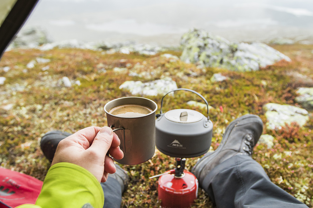 cooking coffee with backpacking stove and kettle