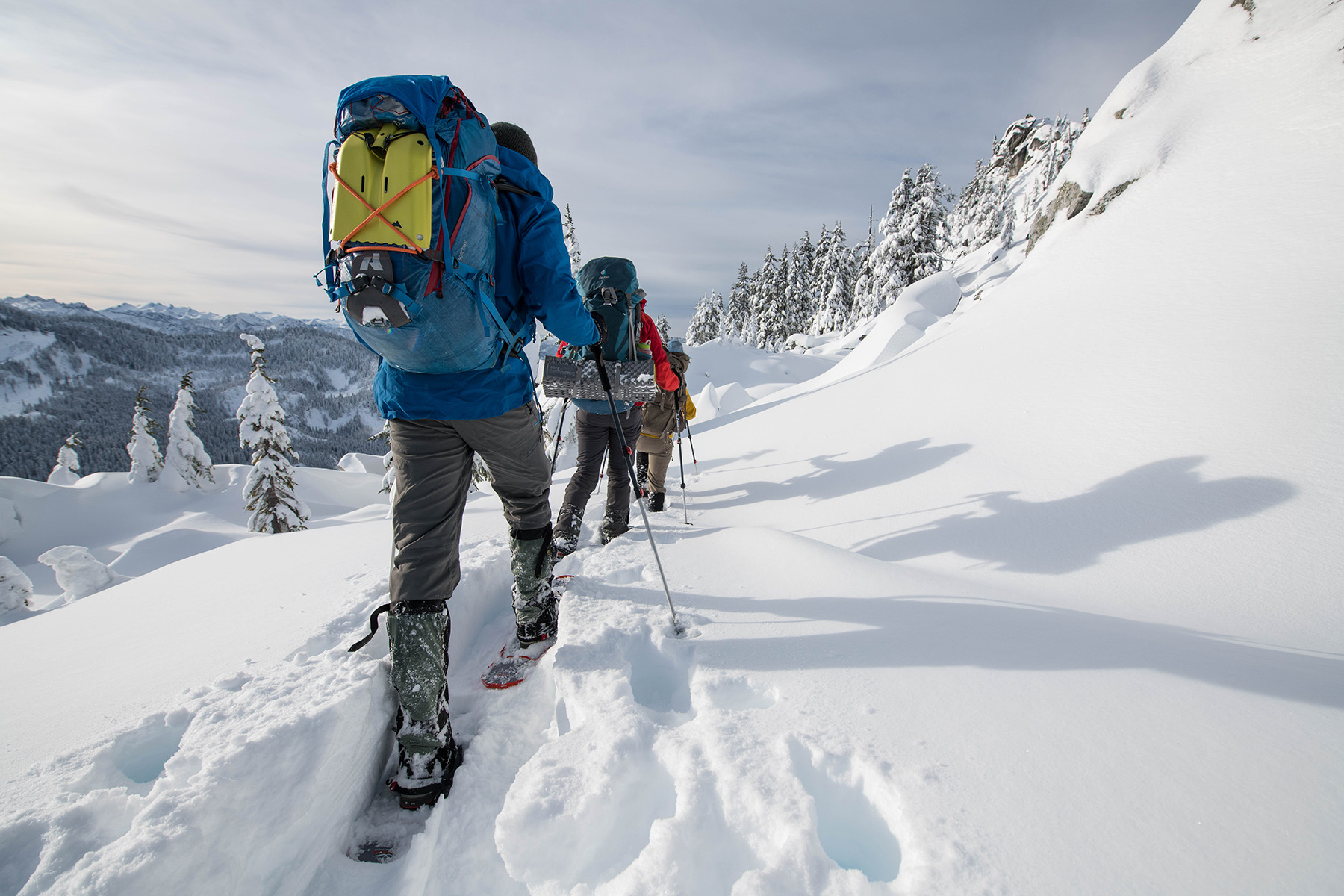 snowshoe sizing with snow tools and pack