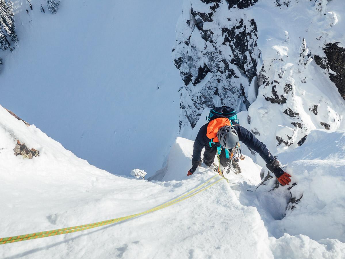 Following up a technical pitch with rare sunshine for Washington's winter climbing season