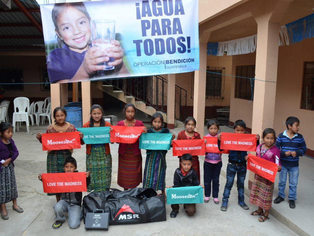 MSR Global Health - Guatemala photo - Kids holding Moosejaw flags