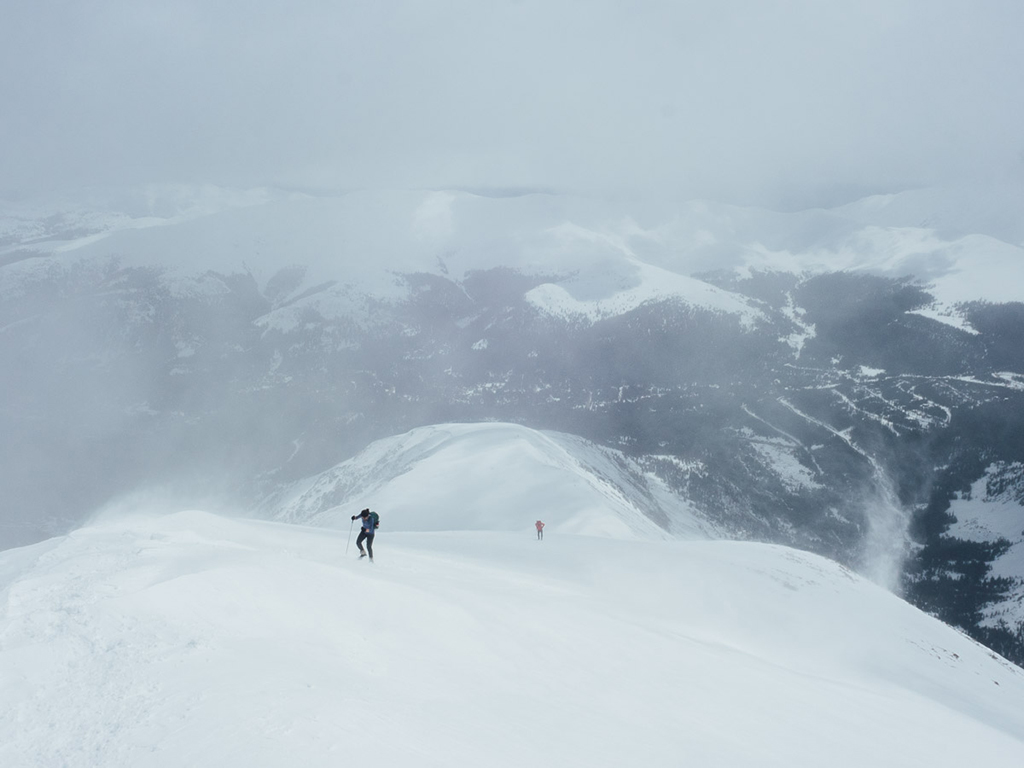 winter climbing on mountain in the fog