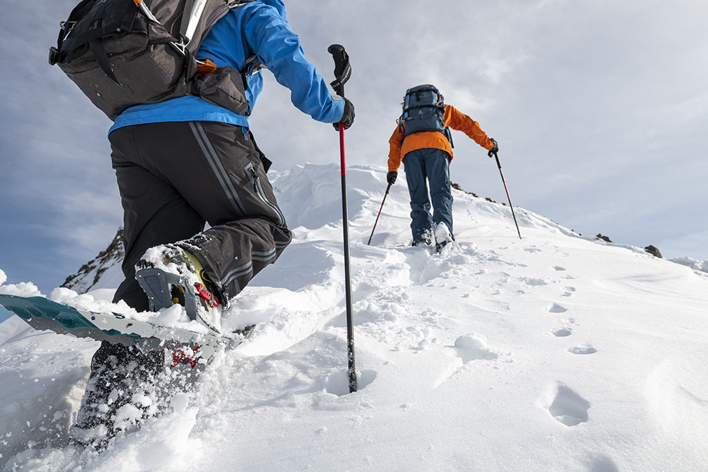 snowshoeing with poles and gear