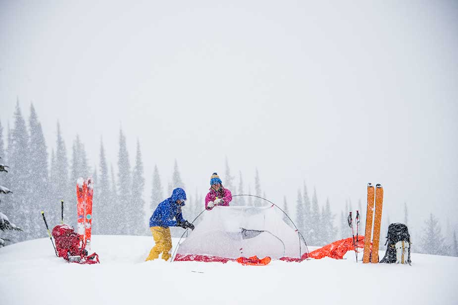 setting up MSR winter tent in the snow