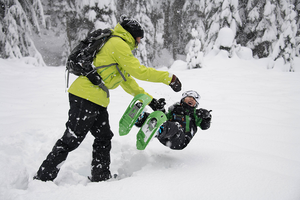 excited kids snowshoeing
