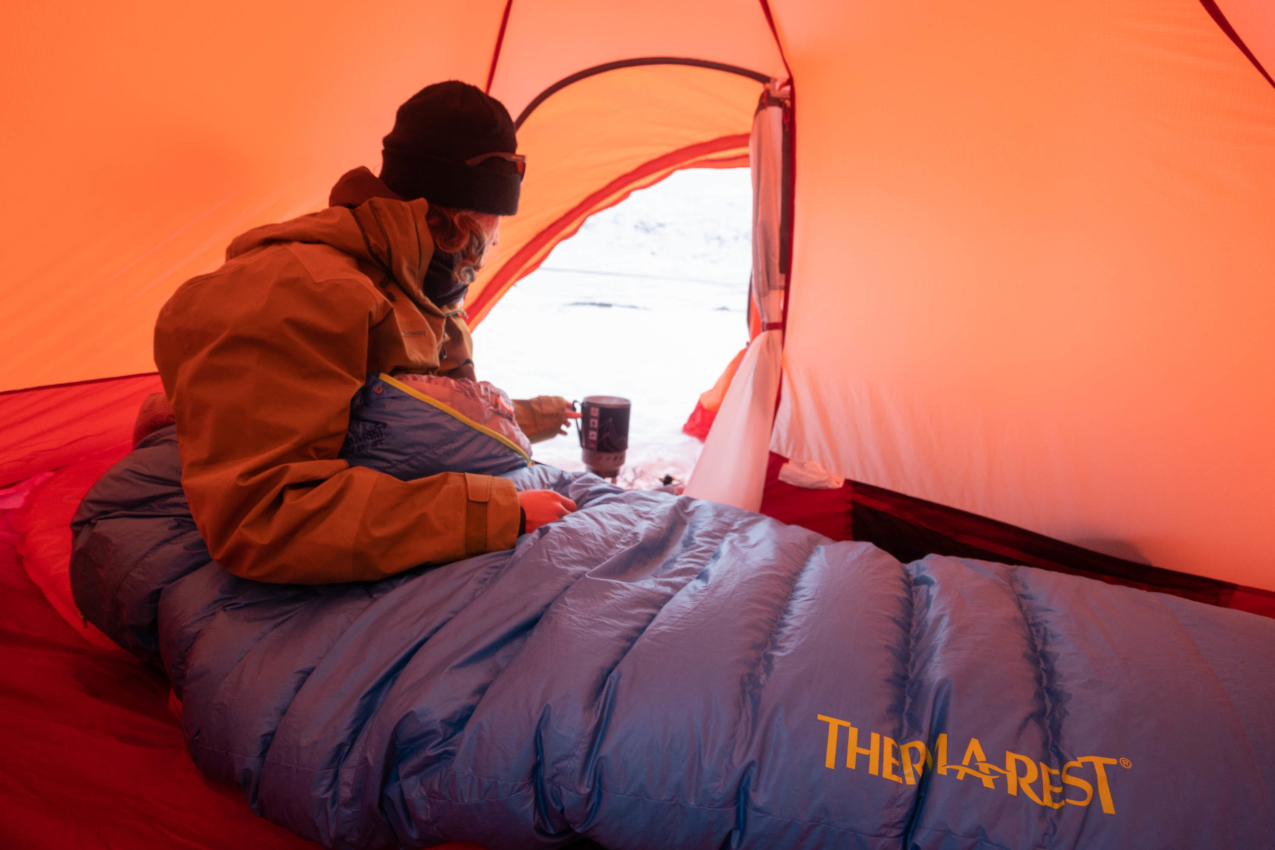 Utilizing at least one warm sleeping pad and potentially layering a sleeping bag with a quilt are excellent components of a sleep system designed to make staying warm while winter camping easier.