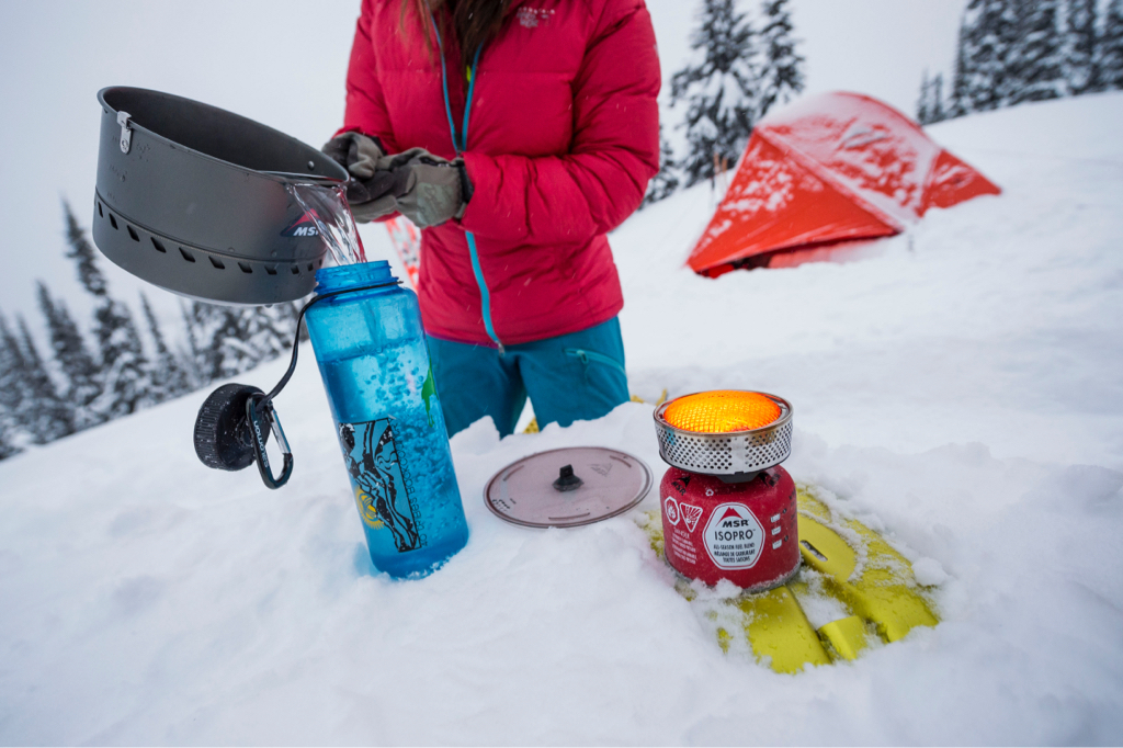 melting snow for water on winter camping trip