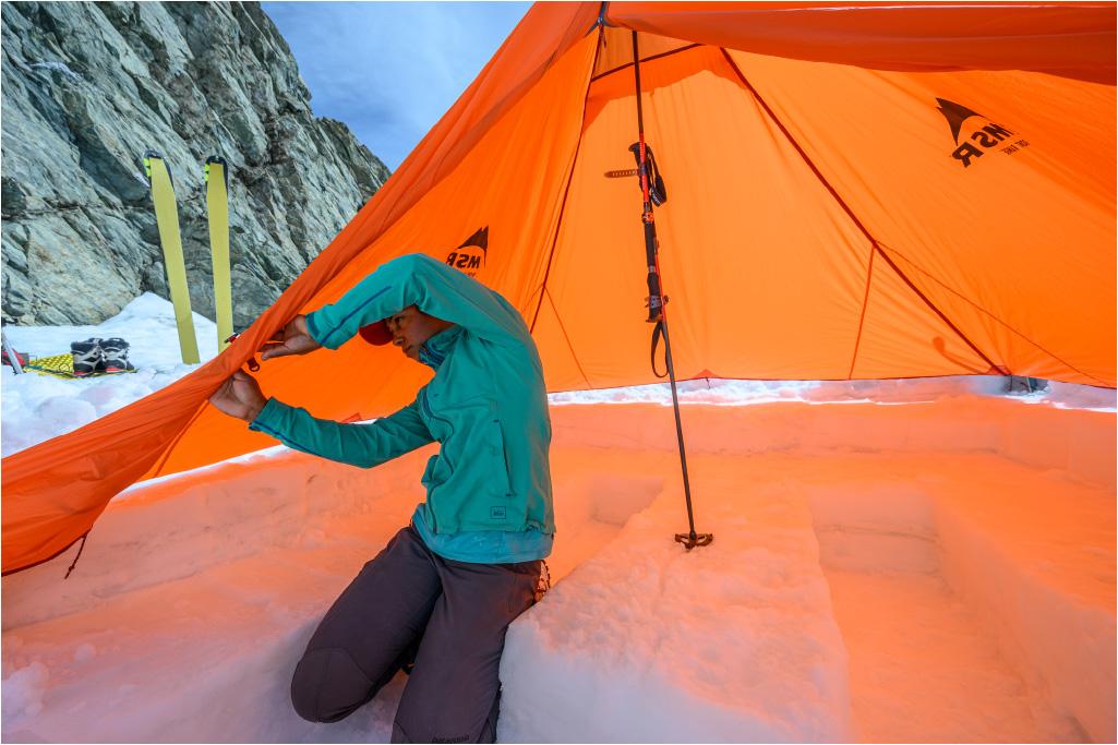 tarp shelter and trekking poles