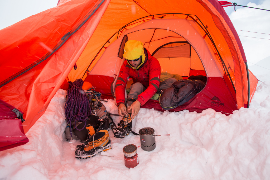 high altitude climber in tent