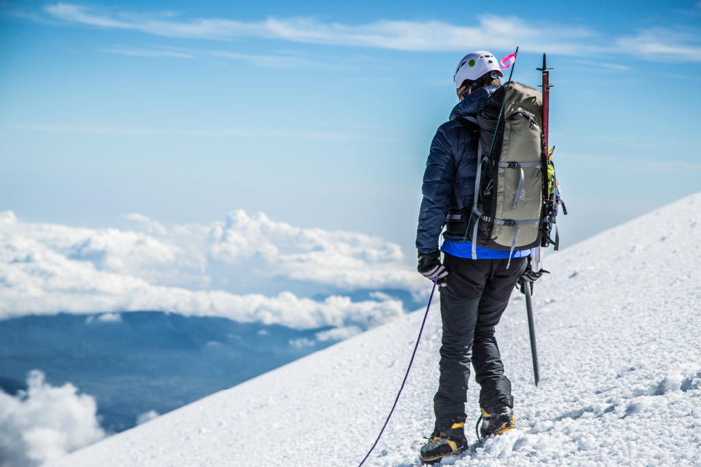 climber taking in high altitude views