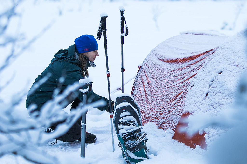 4 season and mountaineering tents setup in the snow