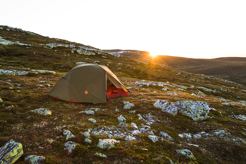 tent in the sun in the morning on cold weather camping trip