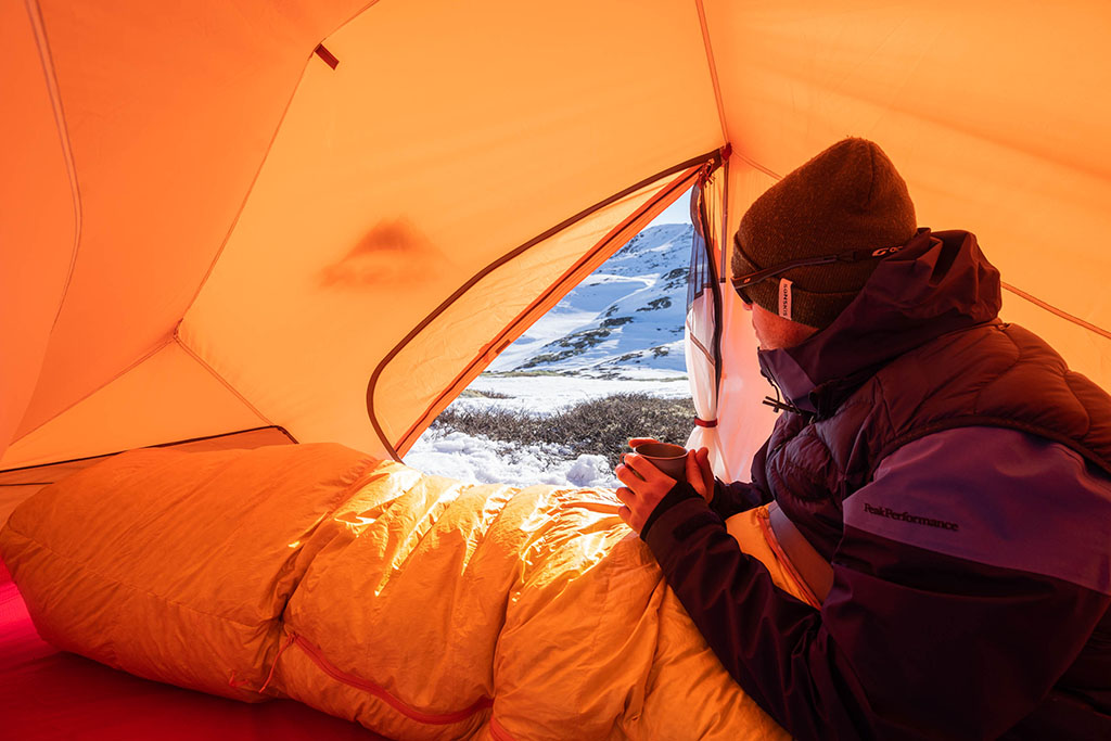 sitting in tent on snowy mountain