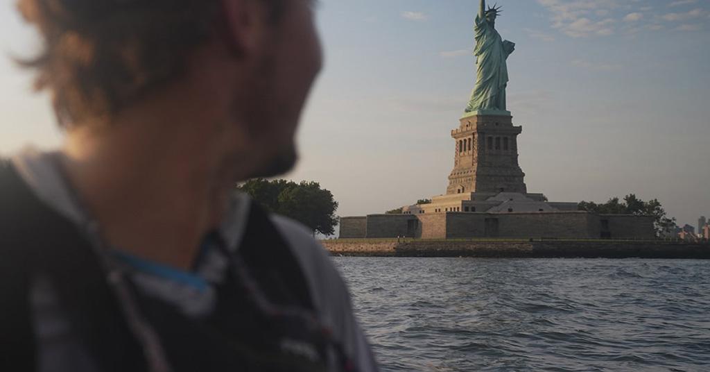 paddling by statue of liberty