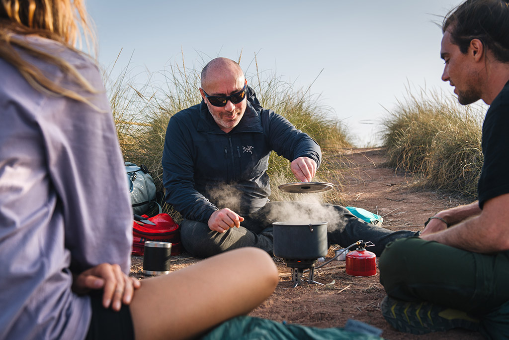 cooking dinner on camp stove