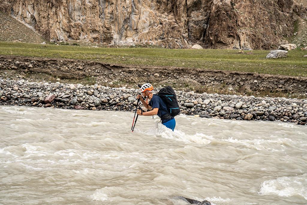 crossing river on climbing trip