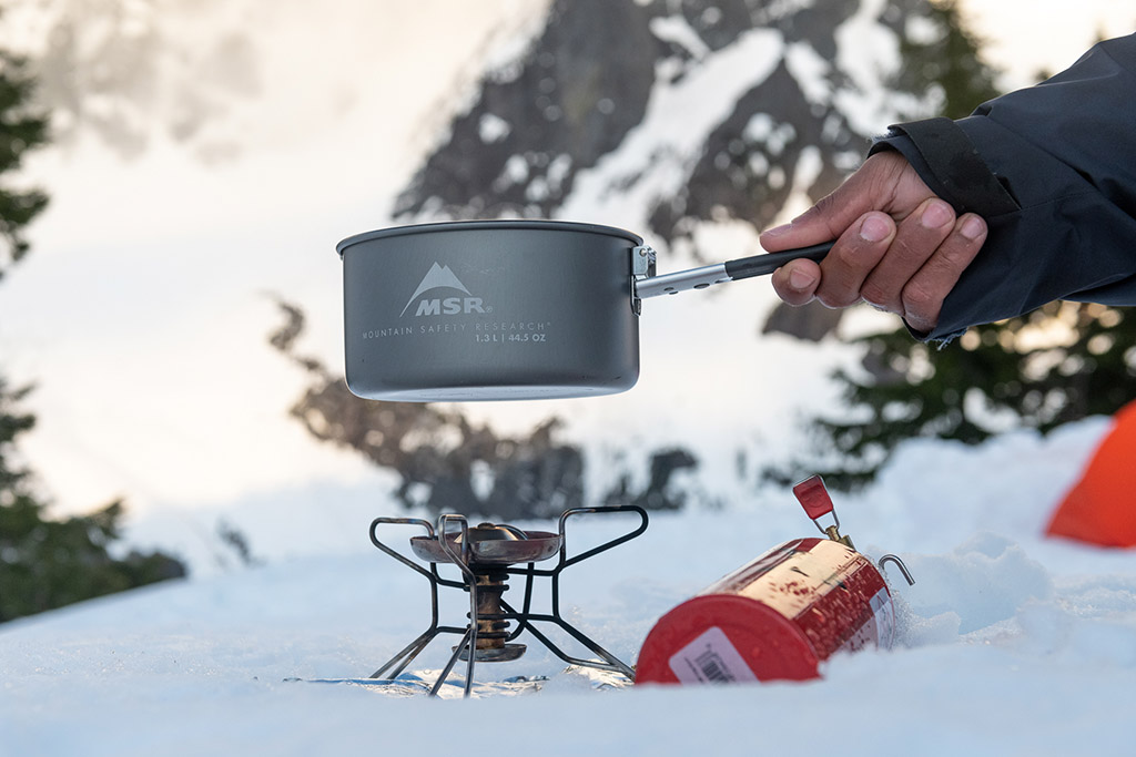 liquid fuel stove in snow